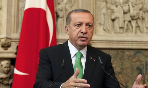 Эрдоган грозит пальцем России