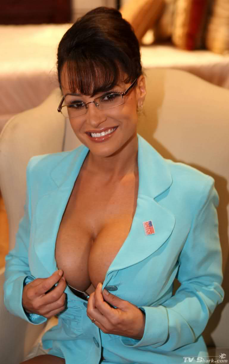 Sexy MILF Lisa Ann exposes her big boobs and bare ass on a red chair  2187464