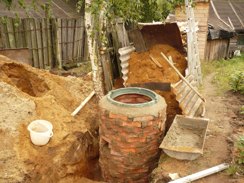Как сделать сливную яму в частном доме своими руками? 60