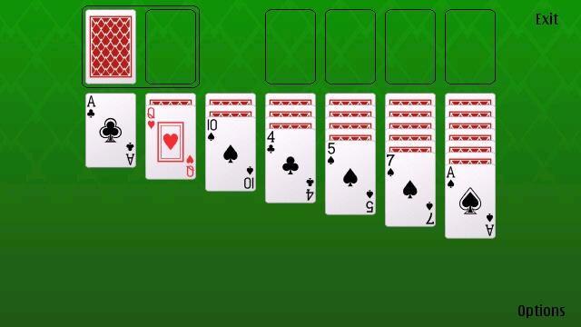 Chicas desnudas jugando a las cartas -