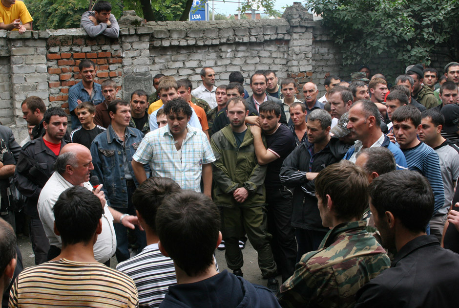 militiamen try to help wounded people in the hospital basement while