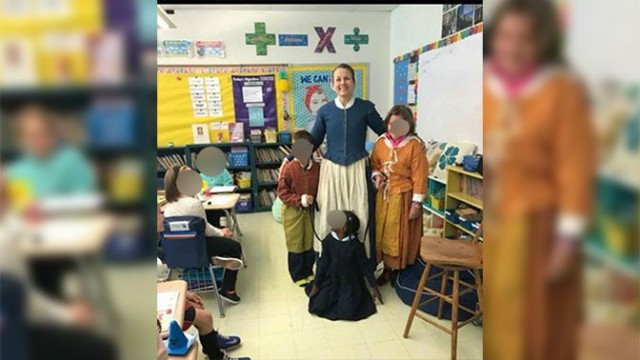 Скандал в США: школьники и учитель сфотографировались с темнокожей девочкой, держа ее на поводке