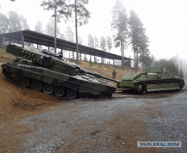 Т-28 вытягивает застрявший леопард-2