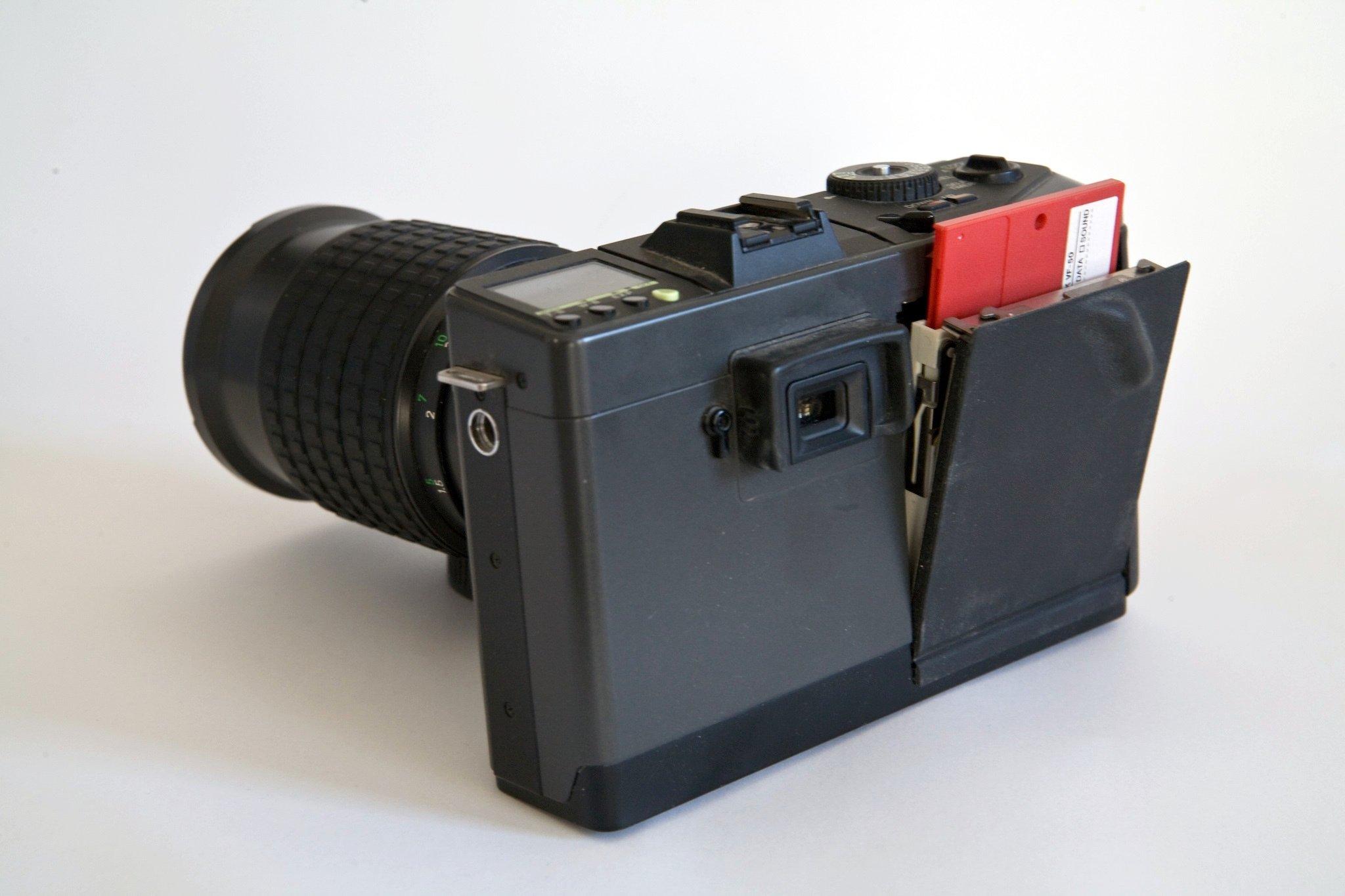 Дейзи уточка с фотоаппаратом решения